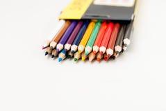 学校颜色铅笔在白色背景说谎 库存图片