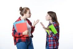学校colledge有固定式书笔记本的少年女孩 免版税图库摄影