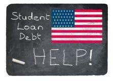 学生使用白垩的贷款概念在板岩黑板 库存图片