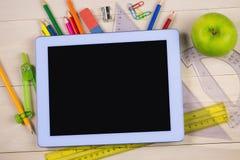 学生制表与学校用品 免版税图库摄影