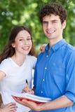 学生夫妇微笑 库存图片