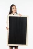 学生的画象,女孩,拿着一个空白的广告牌 免版税库存照片