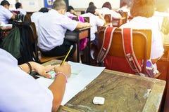 学生通过采取检查 免版税库存图片
