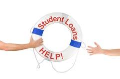 学生贷款帮助救生圈敲响到达手 免版税库存照片