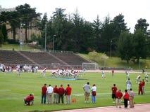 学院足球运动员包括安德鲁行动的运气联盟 免版税库存图片