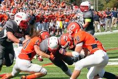 学院NCAA DIV III橄榄球 免版税库存照片