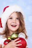 学龄前女孩藏品圣诞节装饰 免版税库存照片