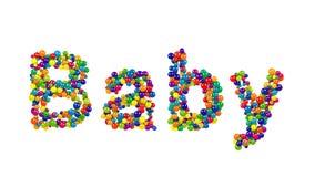婴孩与五颜六色的球的贺卡设计 库存照片