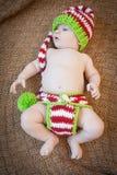 婴孩佩带的假日针织品 库存图片