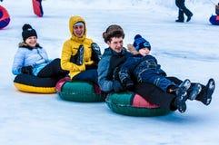 婴孩冬天sledding在乌拉尔河 免版税库存照片