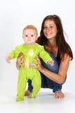 婴孩和保姆 库存图片