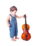 婴孩和小提琴 免版税库存图片