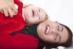 婴孩和母亲圣诞节幸福 免版税库存照片