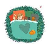 孩子与她的玩具睡觉 免版税库存照片