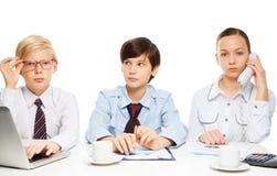 孩子作为成人生意人 免版税库存图片