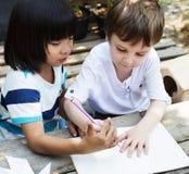 孩子使某一想法一致 图库摄影