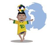 孩子使用和控制足球 免版税库存照片