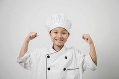 孩子厨师,站立 免版税库存照片