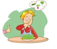 孩子吃菜 免版税图库摄影