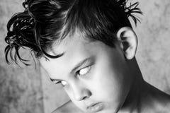 孩子和凉快的理发 图库摄影