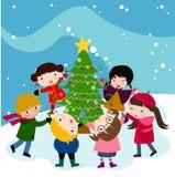 孩子和圣诞树 免版税库存照片