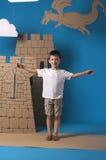 孩子和城堡 免版税库存图片