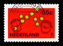 孩子和星, 12月盖印serie,大约1995年 免版税库存照片