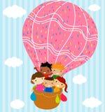 孩子和热的气球 免版税库存照片