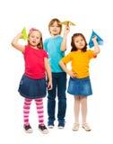 孩子和纸飞机 库存照片