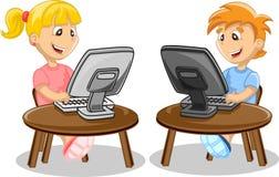 孩子和计算机 免版税库存图片