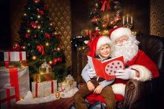 孩子圣诞老人 库存图片