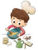 孩子在准备食谱的厨房里 库存照片