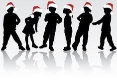 孩子在圣诞老人帽子 库存照片