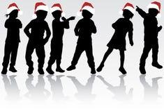 孩子在圣诞老人帽子 免版税库存照片