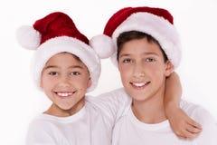 孩子在圣诞老人帽子 库存图片