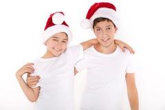 孩子在圣诞老人帽子 免版税库存图片
