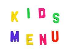 孩子在磁铁菜单s上写字 免版税图库摄影