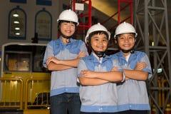 孩子在能源厂 免版税库存图片