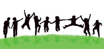 孩子在草甸高兴 免版税库存照片