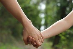 握手的孩子 库存照片