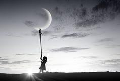 孩子女孩传染性的月亮 库存照片