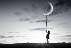 孩子女孩传染性的月亮 库存图片