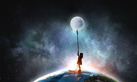 孩子女孩传染性的月亮 免版税图库摄影
