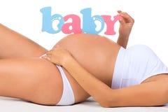 孩子性别:男孩、女孩或者孪生?怀孕的概念 孕妇 免版税库存照片