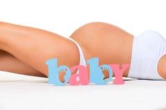 孩子性别:男孩、女孩或者孪生?怀孕的概念 免版税库存图片