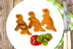 孩子恐龙的鱼矿块 库存图片