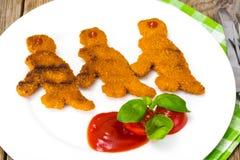 孩子恐龙的鱼矿块 库存照片