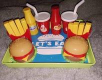 孩子戏弄食物 图库摄影