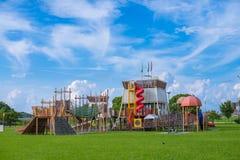 孩子操场在有美丽的云彩的熊本 免版税库存图片