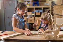 孩子木头工艺 库存照片